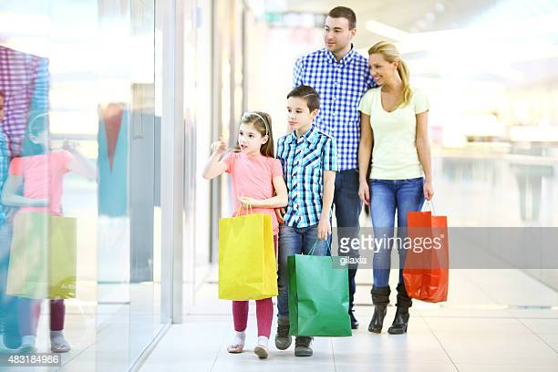 Young family in shopping together.