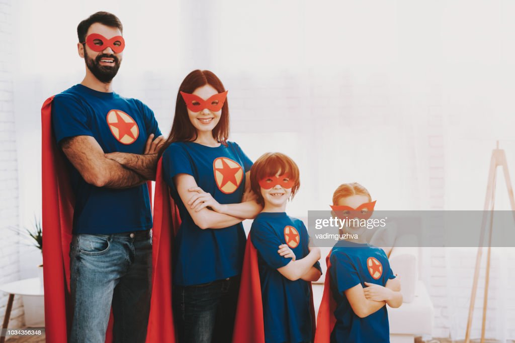 Young Family In Superhero Suits. Posing Concept. : Stock Photo