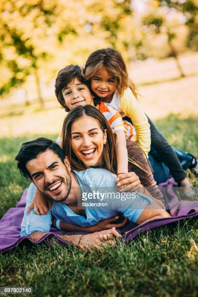 young family in the park - family with two children stock pictures, royalty-free photos & images