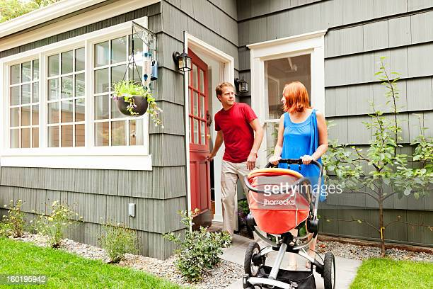 Young Family Leaving Home with Baby Stroller