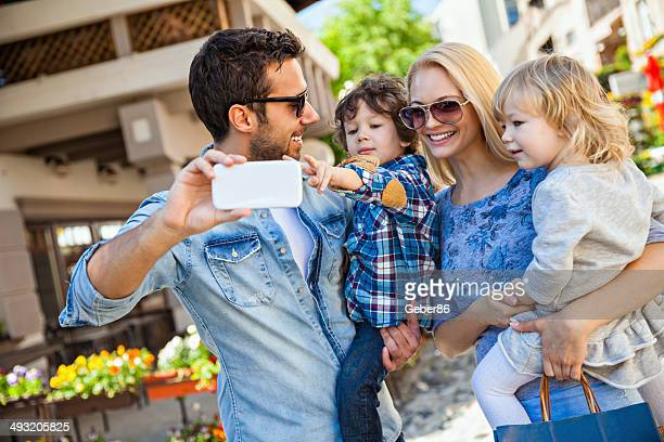 Young family looking at mobile phone