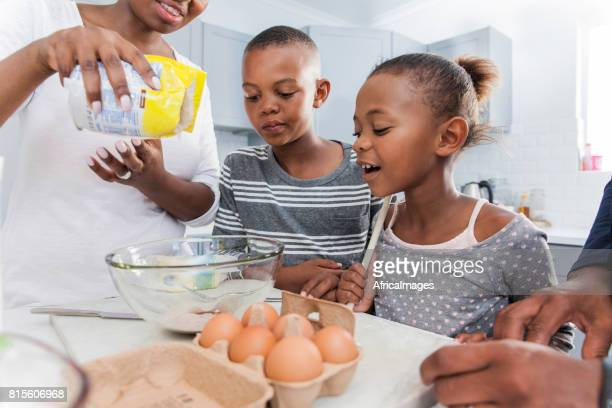 Young family making muffins together