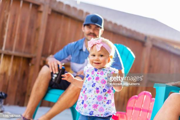 young family millennial parents with female child cookout bbq photo series - eyecrave  stock pictures, royalty-free photos & images