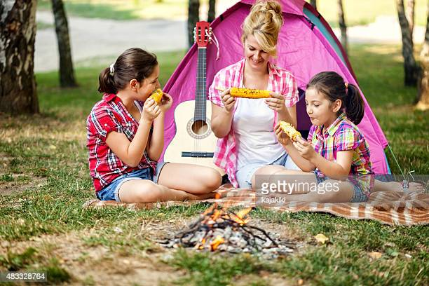 young family on a camping - mother and daughter smoking stock photos and pictures
