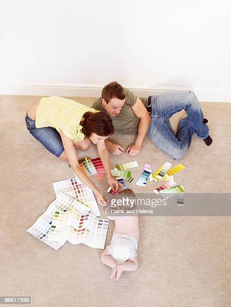Young family on floor with color samples