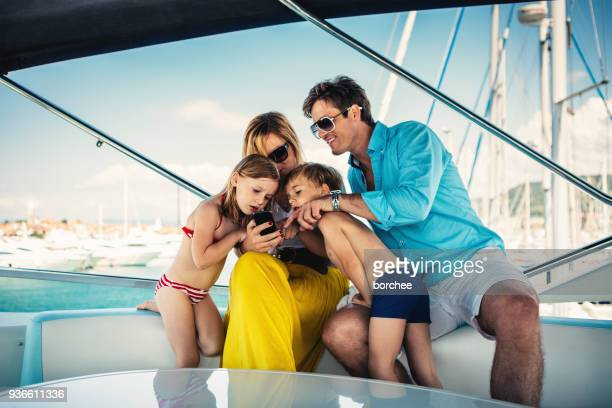 young family on sailing - marina stock pictures, royalty-free photos & images