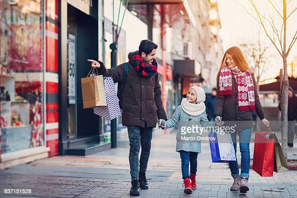 young family on shopping - holiday shopping stock photos and pictures