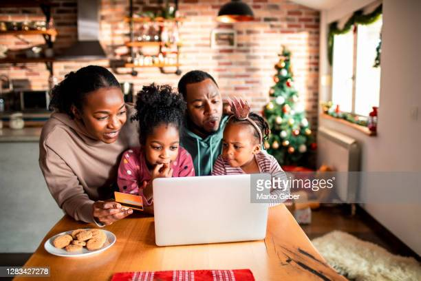young family online christmas shopping - holiday stock pictures, royalty-free photos & images