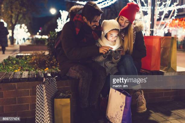 Young family outside at Christmas