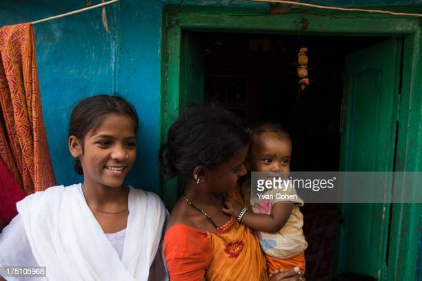 A young family outside their home in the Kolkata slum area of Fakir Bagan They are part of a program of care supported and run by the nonprofit...