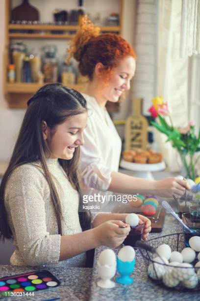 young family painting easter eggs - april stock pictures, royalty-free photos & images