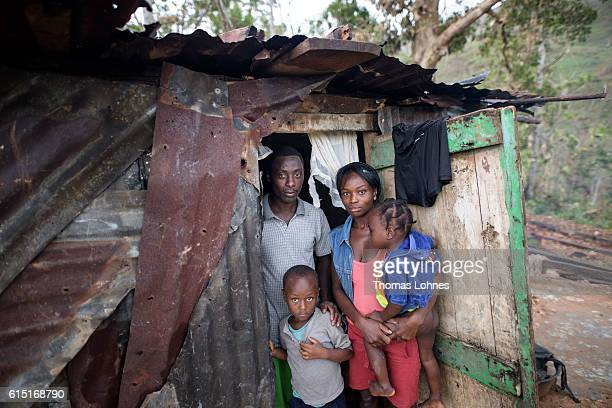 A young family pictured in their provisionally shelter build of old corrugated sheet on October 15 2016 in SautMaturin near Camp Perrin Haiti Matthew...