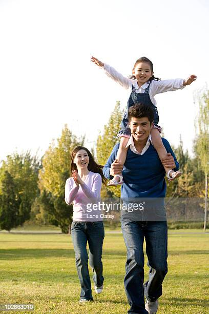 young family playing in the park - in the park day 3 imagens e fotografias de stock