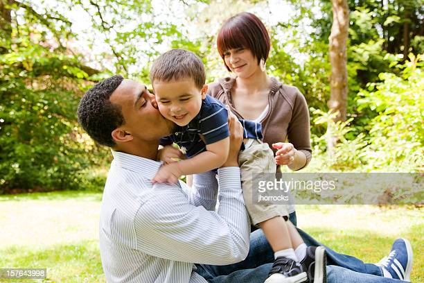 young family playing in the park - real wife sharing stock photos and pictures