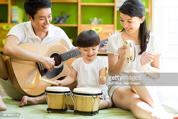 Young family playing musical instruments