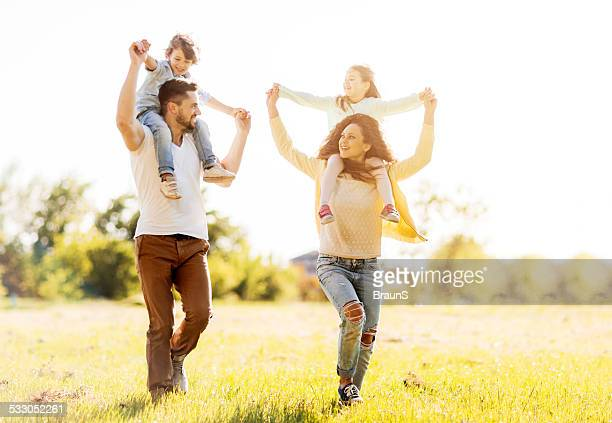 Young family playing outdoors.