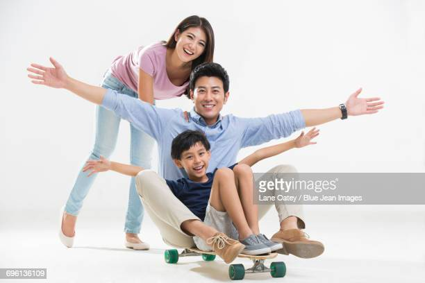 Young family playing with skateboard