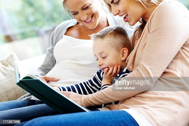 Young family reading story book