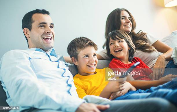 Young family relaxing at home.