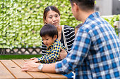 Young family relaxing outdoors together