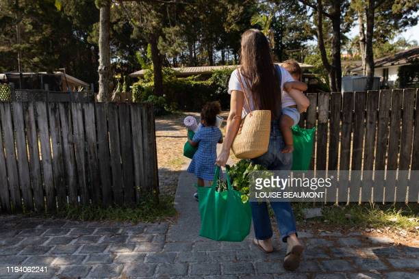 young family reunites after work and school - carrying stock pictures, royalty-free photos & images