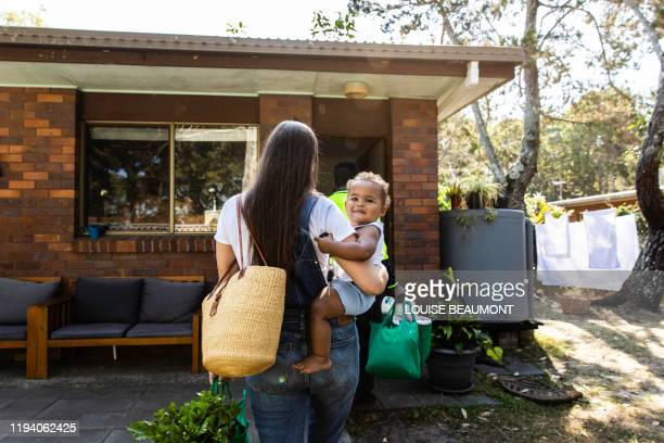 young family reunites after work and school - returning merchandise stock pictures, royalty-free photos & images