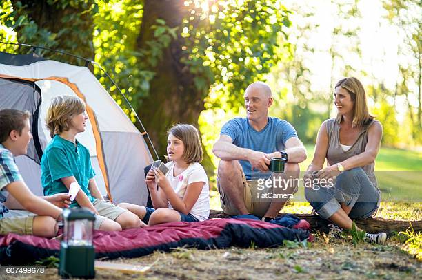 Young family sitting at their campsite enjoying the weekend