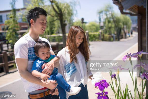 Young family strolling, and watching iris flower