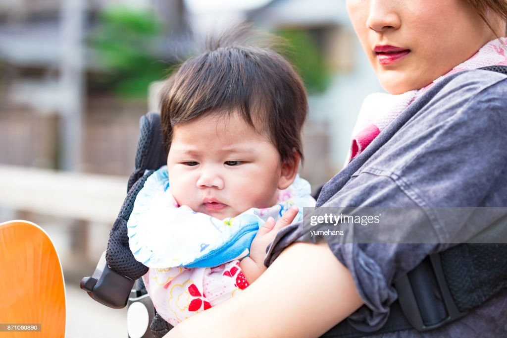 Young family strolling : Stock Photo