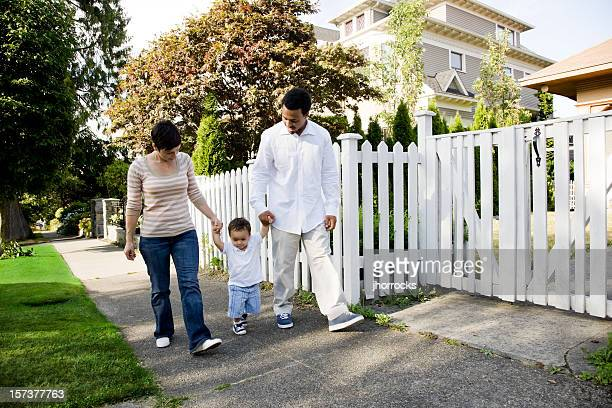 young family taking a stroll - white wife black baby stock photos and pictures