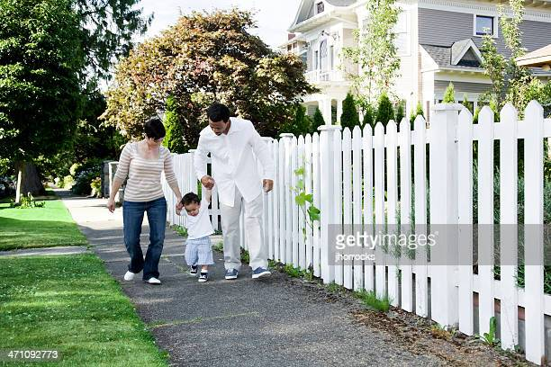 young family taking a walk in the neighborhood - white wife black baby stock photos and pictures