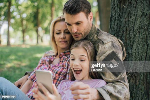 Young family taking selfie together