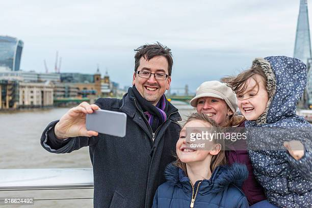 Young Family Taking Vacation Selfie Photo in London as Tourists