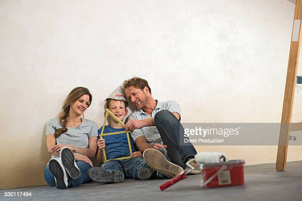Young family together fun happy new home