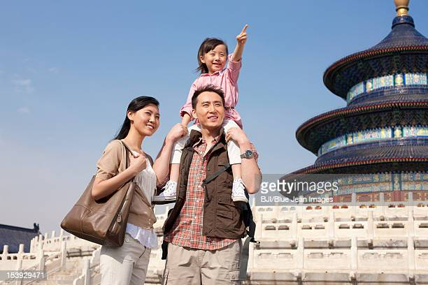 Young family travelling at Temple of Heaven in Beijing, China