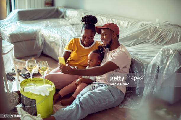 young family using a phone - decoration stock pictures, royalty-free photos & images
