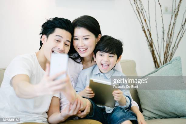 Young family using technological devices