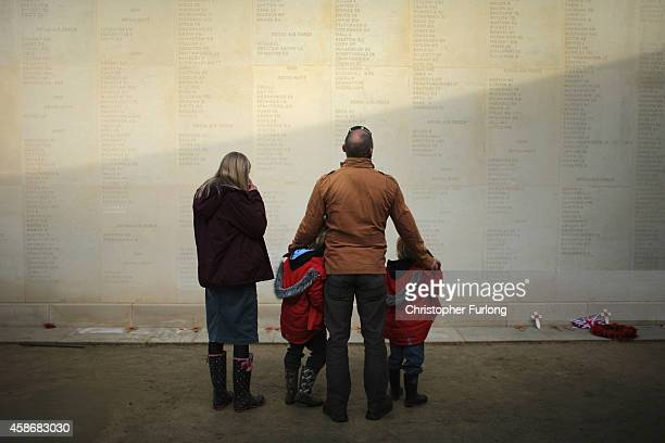 A young family view the names of the fallen as members of the public and veterans gather to commemorate and pay respect to the sacrifice of service...