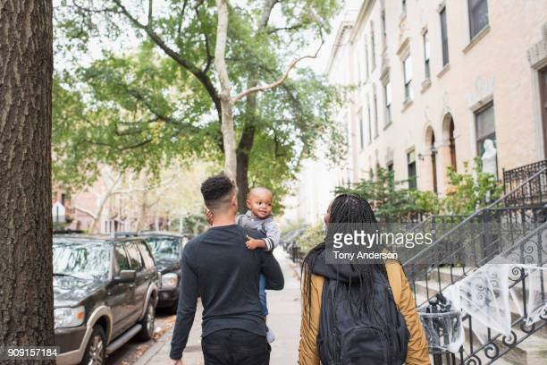 Young family walking in their city neighborhood