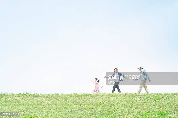 Young family walking on a hill