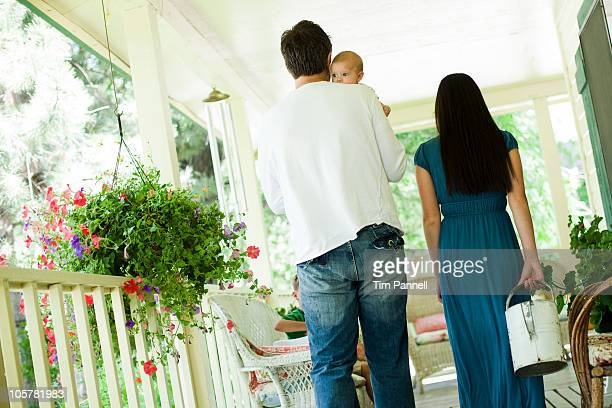 Young family walking on porch