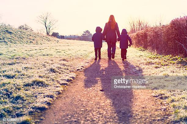 young family walking to school - single mother stock pictures, royalty-free photos & images