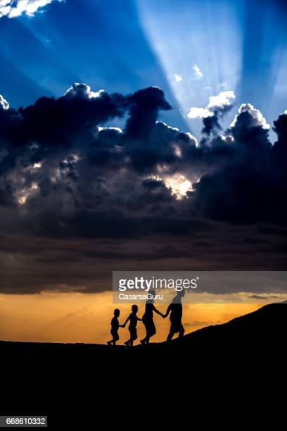 Young Family Walking Together on Dust