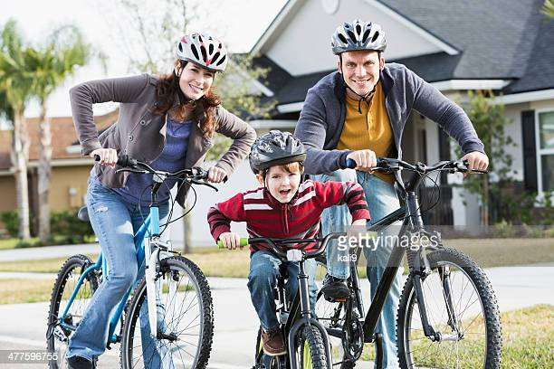 Young family with a little boy riding bikes