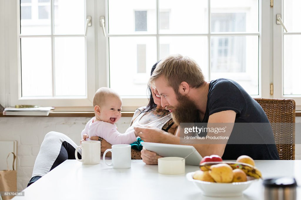 Young Family With Baby having Fun : Stock Photo