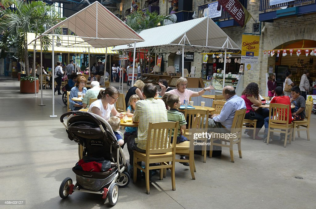 Young family with children at market food cort : Stock Photo