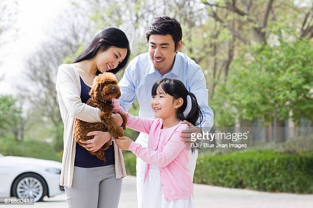Young family with their pet dog