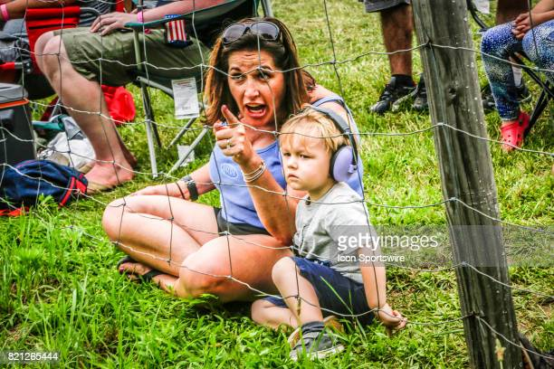 Young fan and parent look on during the IMSA WeatherTech SportsCar Championship Northeast Grand Prix on July 22 at Lime Rock Park in Lakeville CT