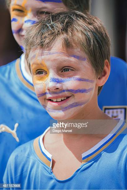 A young fan arrives before the Group D match between Italy and Uruguay at Estadio das Dunas during the 2014 World Cup on June 24 2014 in Natal Brazil