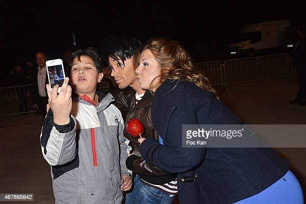 A young fan Bruno Moneroe and Cindy Lopes pose for a selfie during 'La Foire du Trone 2015' Launch Party At Pelouse De Reuilly in Benefit of Le...